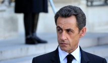 France's President Sarkozy listens to Spain's Prime Minister Rodriguez Zapatero delivering a speech following a bilateral meeting at the Elysee Palace