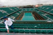 A maintenance worker walk in the tribune of the Philippe Chartrier court as the men's singles final match was suspended for the day after rain stopped play during the French Open tennis tournament in Paris