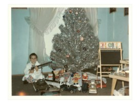 boy-with-gun-and-fake-christmas-tree