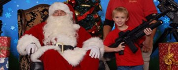 Christmas photos feature kids with guns